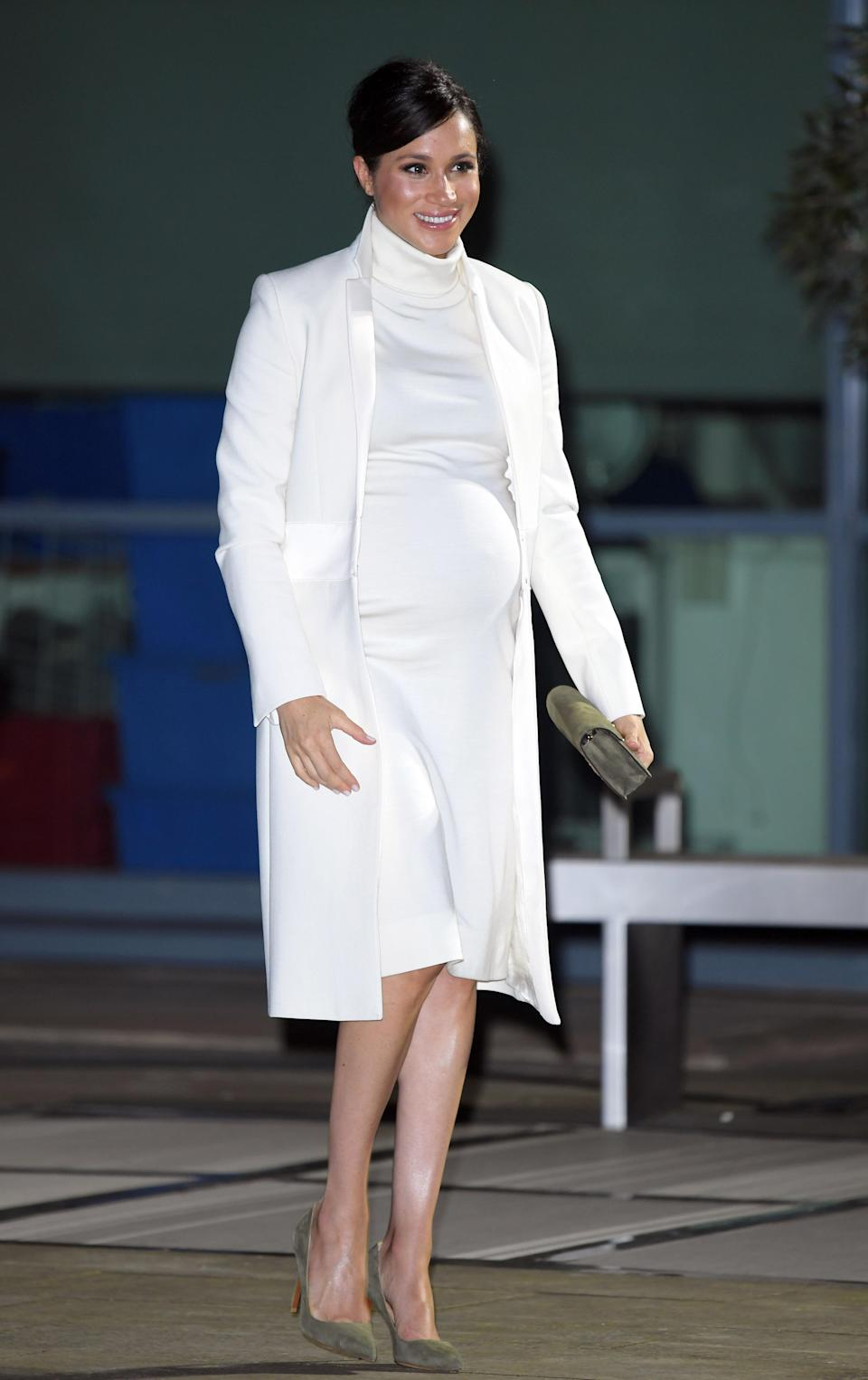 For a performance of 'The Wider Earth' at the Natural History Museum, the royal recycled her Amanda Wakeley coat with a Calvin Klein Resort 2019 collection roll-neck dress. A khaki Ralph Laurent clutch and co-ordinating shoes finished the winter ensemble. [Photo: Getty]