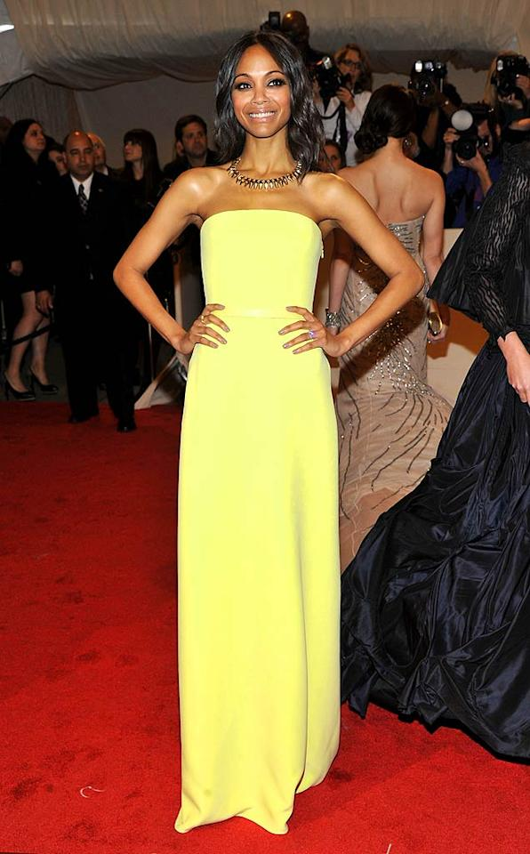 """Zoe Saldana, 33, has a knack for always looking perfectly polished -- especially on the red carpet. The """"Avatar"""" actress chose a pretty pale yellow Calvin Klein dress and a glam gold statement necklace for the 2011 Met Gala in NYC. Stephen Lovekin/"""