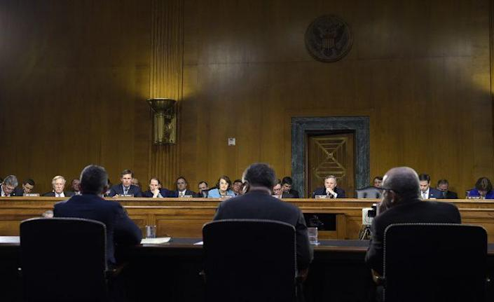 Clint Watts, Eugene Rumer, and Roy Godson testify before the Senate intelligence committee on Capitol Hill on March 30, 2017.