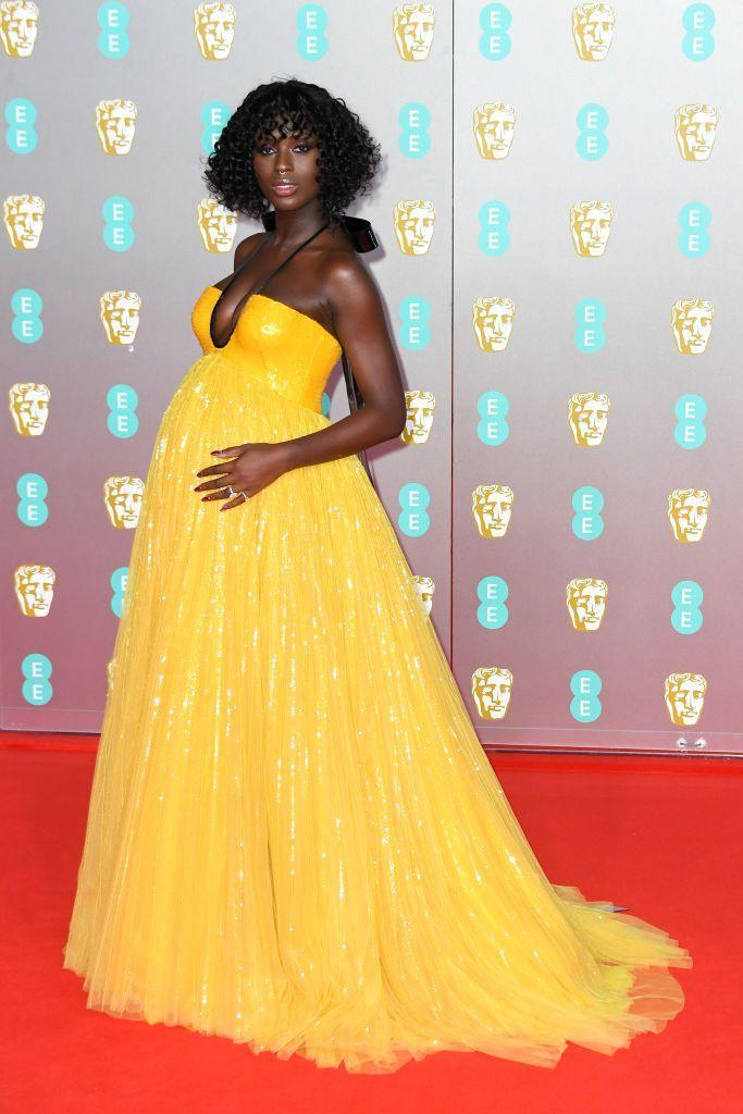 <p>The pregnant star glowed in a bright yellow Gucci gown for the BAFTAs.</p>