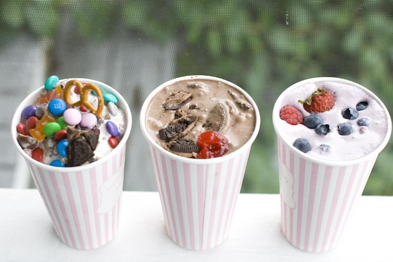 This July 22, 2013 photo shows, from left to right, Concession Stand, Dark Horse Cherry, Berry Basket DIY ice cream flurries in Concord, N.H. (AP Photo/Matthew Mead)