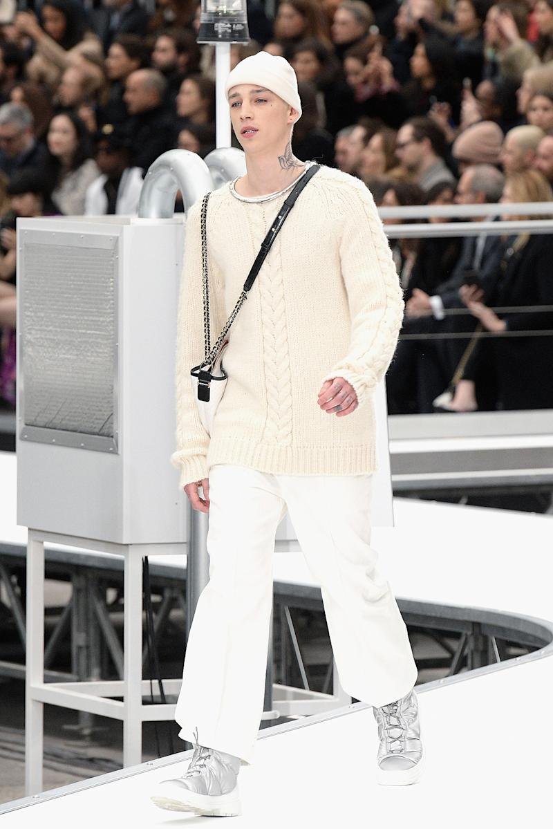 Lily Rose Depp's boyfriend, Ash Stymest walks the runway during the Chanel Paris show as part of the Paris Fashion Week Womenswear Fall/Winter 2017/2018 on March 7, 2017 in Paris, France. (Photo: Getty Images)