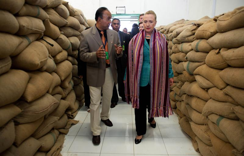 U.S. Secretary of State Hillary Rodham Clinton, right, talks with Agribusiness Advisor Bency Isaac, left, as she tours the Timor Coffee Cooperative in Dili, East Timor Thursday, Sept. 6, 2012. U.S. Secretary of State Hillary Rodham Clinton is in East Timor to offer the small half-island nation support as it ends its reliance on international peacekeepers. (AP Photo/Jim Watson, Pool)