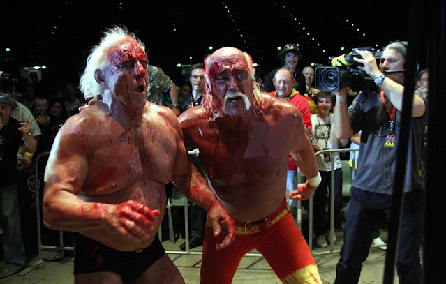 <p>Hulk Hogan and Ric Flair in action during his Hulkamania Tour at the Burswood Dome on November 24, 2009 in Perth, Australia. (Photo by Matt Jelonek/WireImage) </p>