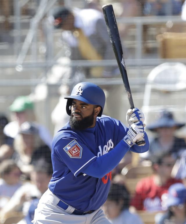 Los Angeles Dodgers' Andrew Toles bats during the first inning of a spring training baseball game against the Chicago White Sox, Friday, March 2, 2018, in Glendale, Ariz. (AP Photo/Carlos Osorio)