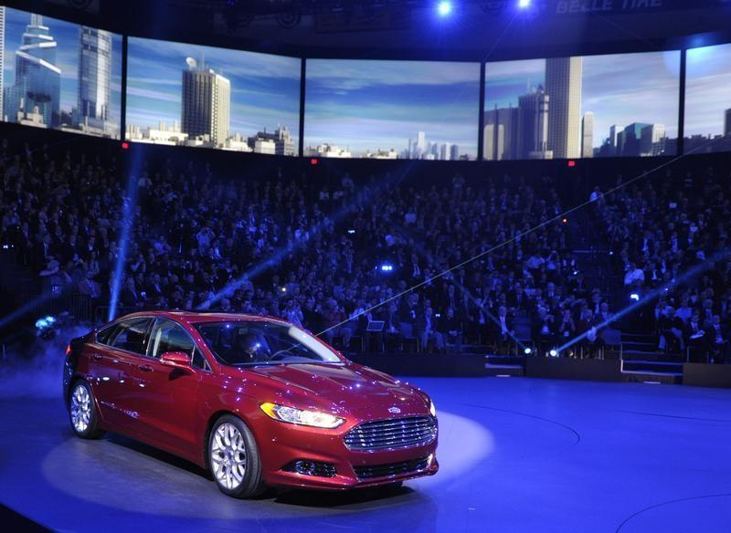 The 2013 Ford Fusion is unveiled on the first press preview day for the North American International Auto Show in Detroit