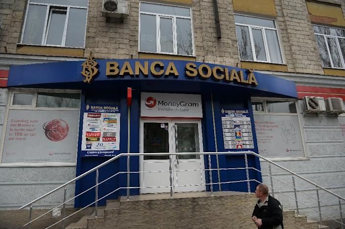 The case of the vanishing billion came to light when the Central Bank of Moldova discovered that three banks have given out loans worth a total of $1 billion, or 15 percent of the impoverished ex-Soviet state's GDP (AFP Photo/Daniel Mihailescu)
