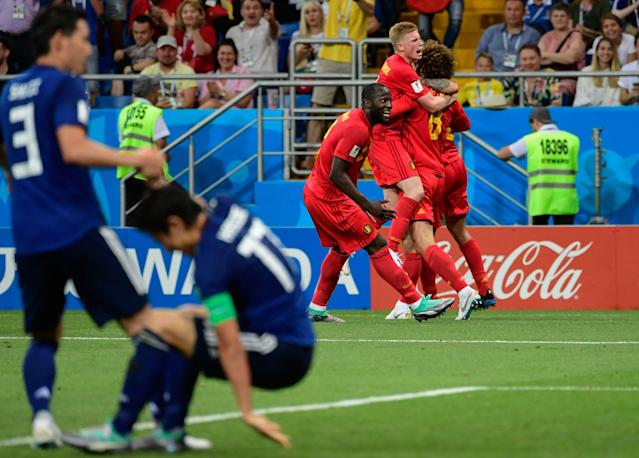 <p>Belgium's midfielder Marouane Fellaini (R) celebrates with Belgium's midfielder Kevin De Bruyne (2R) and Belgium's forward Romelu Lukaku (3R) after scoring their second goal during the Russia 2018 World Cup round of 16 football match between Belgium and Japan at the Rostov Arena in Rostov-On-Don on July 2, 2018. (Photo by PIERRE-PHILIPPE MARCOU / AFP) </p>