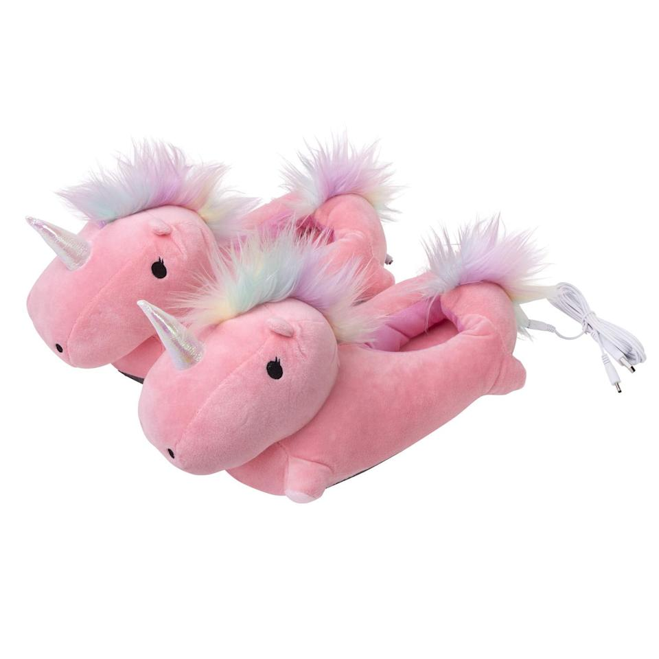 """<p>Plug these <a href=""""https://www.popsugar.com/buy/SMOKO-Adorable-Plush-Unicorn-Heated-Foot-Warmer-Slippers-388311?p_name=SMOKO%20Adorable%20Plush%20Unicorn%20Heated%20Foot%20Warmer%20Slippers&retailer=amazon.com&pid=388311&price=47&evar1=tres%3Aus&evar9=39154948&evar98=https%3A%2F%2Fwww.popsugar.com%2Flove%2Fphoto-gallery%2F39154948%2Fimage%2F45500551%2FSMOKO-Adorable-Plush-Unicorn-Heated-Foot-Warmer-Slippers&list1=gifts%2Choliday%2Cwomen%2Cchristmas%2Cgift%20guide%2Cunicorn%2Cgifts%20for%20women&prop13=mobile&pdata=1"""" rel=""""nofollow"""" data-shoppable-link=""""1"""" target=""""_blank"""" class=""""ga-track"""" data-ga-category=""""Related"""" data-ga-label=""""https://www.amazon.com/Adorable-Unicorn-Heated-Warmer-Slippers/dp/B07898H9W3"""" data-ga-action=""""In-Line Links"""">SMOKO Adorable Plush Unicorn Heated Foot Warmer Slippers</a> ($47) in and they heat up!</p>"""
