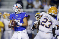 Boise State quarterback Hank Bachmeier (19) looks downfield during the first half of the team's NCAA college football game against UTEP on Friday, Sept. 10, 2021, in Boise, Idaho. (AP Photo/Steve Conner)
