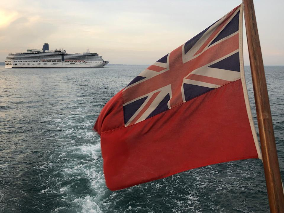 Sailing by: P&O's Arcadia as seen from a pleasure boat off the coast of Dorset (Simon Calder)