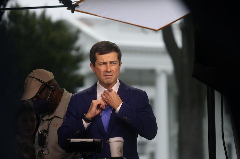 U.S. Secretary of Transportation Pete Buttigieg prepares to give a live interview to the news media outside of the White House in Washington, U.S., October 13, 2021. (Leah Millis/Reuters)