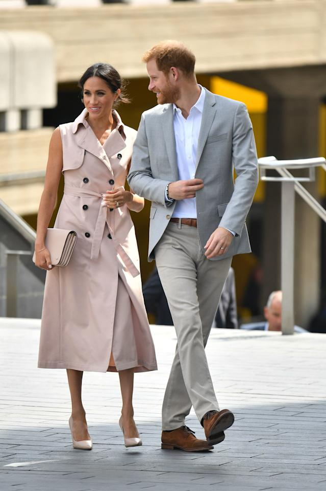 <p>On 17 July, the Duke and Duchess of Sussex visited the Nelson Mandela Centenary Exhibition at the Southbank Centre. For the outing, the Duchess opted for a sleeveless trench dress by House of Nonie teamed with a co-ordinating Mulberry clutch. Hands up, who else is pleased to see the return of her trademark messy bun? <em>[Photo: PA]</em> </p>
