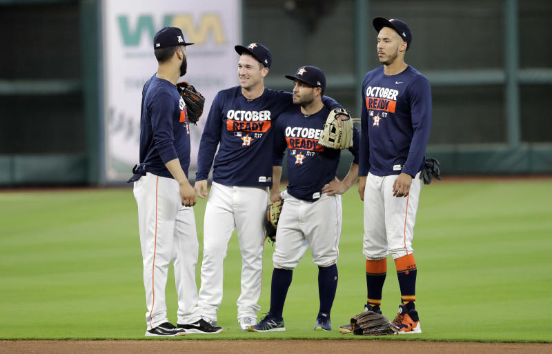 Alex Bregman, center with teammates Jose Altuve, Carlos Correa and Marwin Gonzalez. (AP)