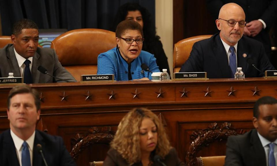 """<span class=""""element-image__caption"""">Karen Bass votes for the first of two articles of impeachment against Donald Trump, 13 December 2019.</span> <span class=""""element-image__credit"""">Photograph: Chip Somodevilla/POOL/EPA</span>"""
