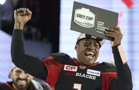 Ottawa Redblacks quarterback Henry Burris holds up the Grey Cup MVP award after the Redblacks defeated the Calgary Stampeders in the Canadian Football League's (CFL) 104th Grey Cup championship game in Toronto, Ontario, Canada November 27, 2016. REUTERS/Fred Thornhill