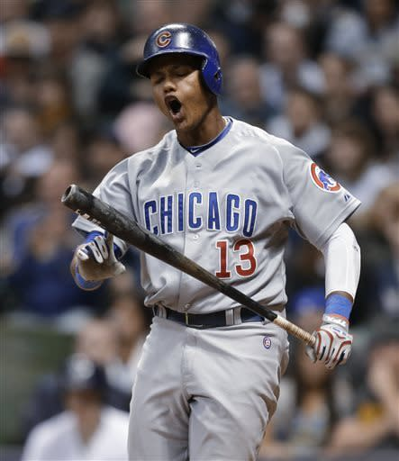 Chicago Cubs' Starlin Castro reacts after striking out against the Milwaukee Brewers during the eighth inning of a baseball game Saturday, April 20, 2013, in Milwaukee. (AP Photo/Jeffrey Phelps)