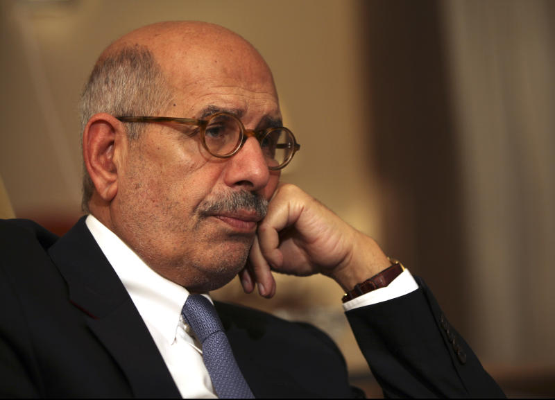 """FILE - In this Saturday, Nov. 24, 2013 file photo, leading democracy advocate Mohammed ElBaradei speaks to a handful of journalists including the Associated Press, at his home on the outskirts of Cairo, Egypt. Mohamed ElBaradei, who leads the main opposition National Salvation Front, wrote on Twitter Saturday, Feb. 23, 2013 that he is calling for the boycott """"to expose sham democracy,"""" as he said he did in a similar call in 2010 under then-president Hosni Mubarak. ElBaradei says he urges the boycott of the vote called by Islamist President Mohammed Morsi because he """"will not be part of an act of deception.""""(AP Photo/Thomas Hartwell, File)"""