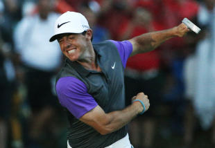 Rory McIlroy celebrates after winning the PGA Championship. (AP)