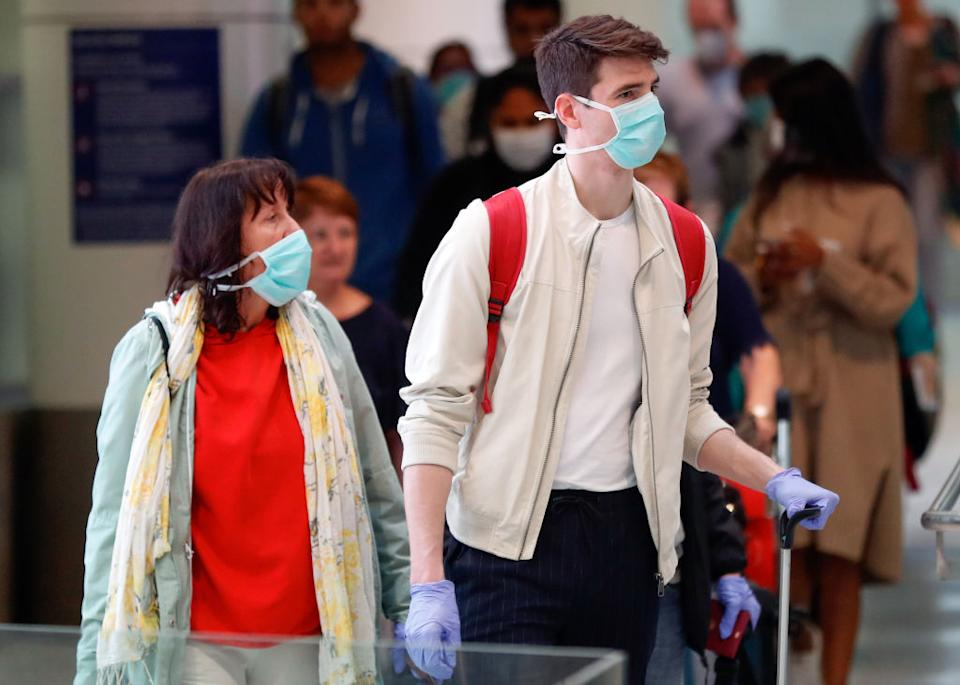 Passengers arrives at Sydney airport on March 16. Source: Getty