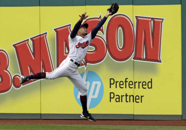 Cleveland Indians' Oscar Mercado catches a ball hit by Oakland Athletics' Matt Chapman in the third inning of a baseball game, Tuesday, May 21, 2019, in Cleveland. Chapman was out on the play. (AP Photo/Tony Dejak)