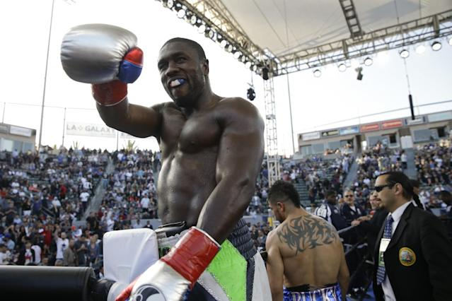 Andre Berto celebrates his fourth-round knockout win against Victor Ortiz on April 30, 2016. (AP)