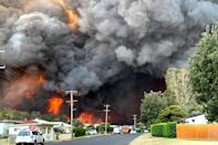 An out-of-control bushfire burns in Harrington, some 335 kilometres (210 miles) northeast of Sydney