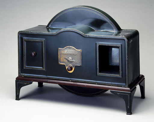 """John Logie Baird's television, 1926. Robinson says, """"If I was on a desert island, the TV would be my number one invention to bring with me, if I could.  It has transformed our homes and revolutionised entertainment, which I – after making my first programme at 13 – have been lucky enough to be part of.  It forms many of my earliest memories.  For example, I vividly remember sitting under my mum's table while I was a very young boy and excitedly watching the Queen Coronation."""" (Image: Science Museum)"""