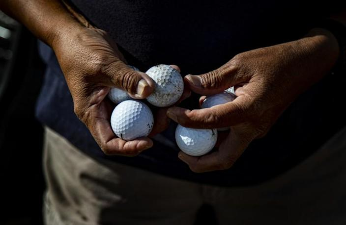 STEAMBOAT, AZ - JULY 19, 2019: Navajo Indian Emmett Francis, 76, chooses a golf ball before playing the Rez Golf Course on the Navajo Reservation July 19, 2019 in Steamboat, Arizona. The course is on sprawling parched land filled with native sage, canyons and mostly dirt.(Gina Ferazzi/Los AngelesTimes)
