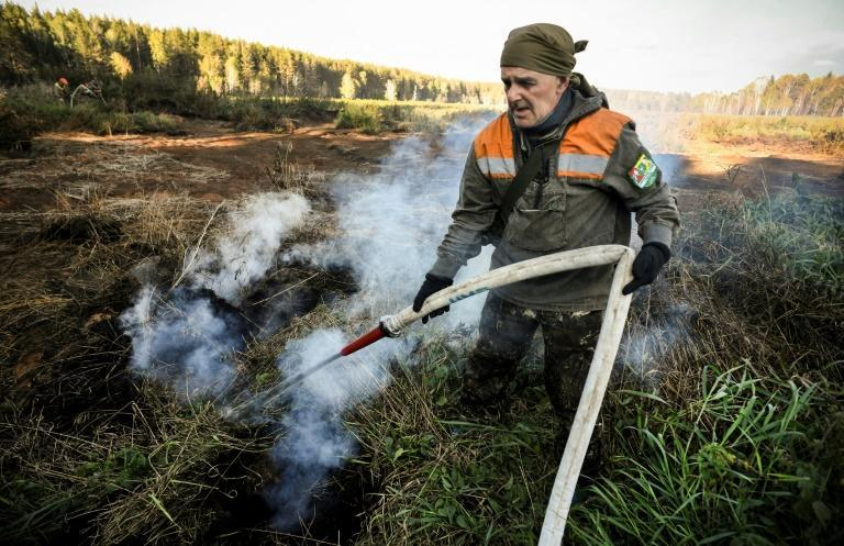 """Water-resistant, underground peatland blazes in Russia's Arctic circle are """"climate bombs"""", environmental activists say"""