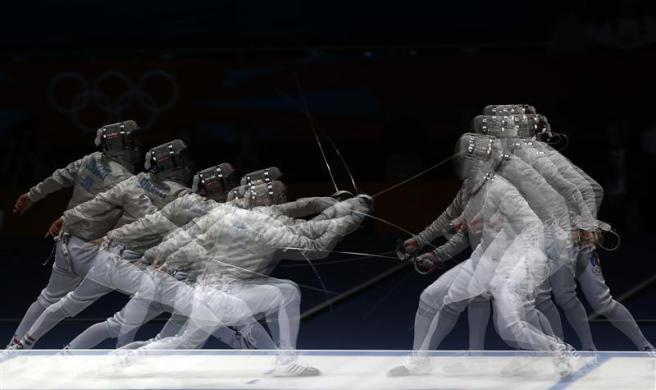 Hungary's Aron Szilagyi (L) competes against Russia's Nikolay Kovalev during their men's sabre individual semifinal fencing competition at the ExCel venue at the London 2012 Olympic Games July 29, 2012.