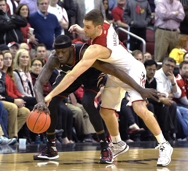 Louisville's Luke Hancock, right, attempts to knock the ball away from Cincinnati's Justin Jackson during the second half of an NCAA college basketball game Thursday, Jan. 30, 2014, in Louisville, Ky. Cincinnati defeated Louisville 69-66. (AP Photo/Timothy D. Easley)