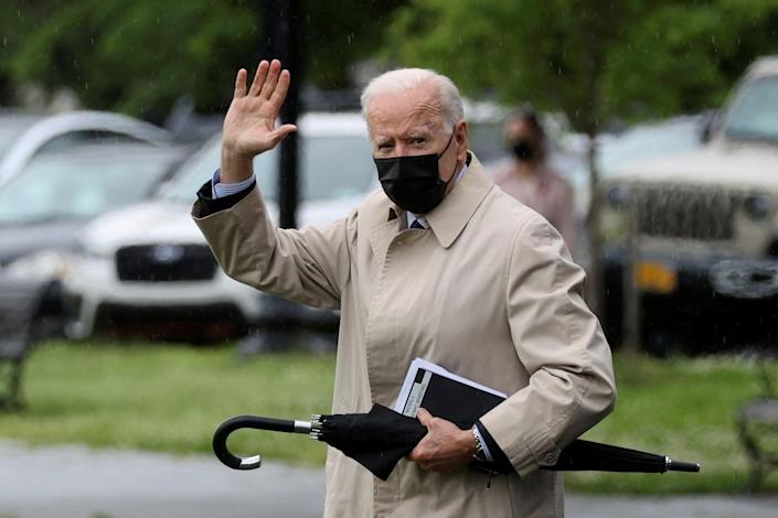 Joe Biden waves before boarding the Marine One helicopter for a planned weekend at Camp David (REUTERS)