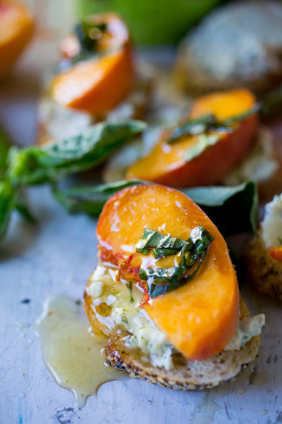 "<p><span class=""redactor-invisible-space"">The sweet combination of peach and honey is offset by a savory smothering of goat cheese.</span></p><p><strong>Get the recipe at <a href=""http://www.feastingathome.com/peach-bruschetta-with-goat-cheese/"" rel=""nofollow noopener"" target=""_blank"" data-ylk=""slk:Feasting at Home"" class=""link rapid-noclick-resp"">Feasting at Home</a>.</strong></p>"