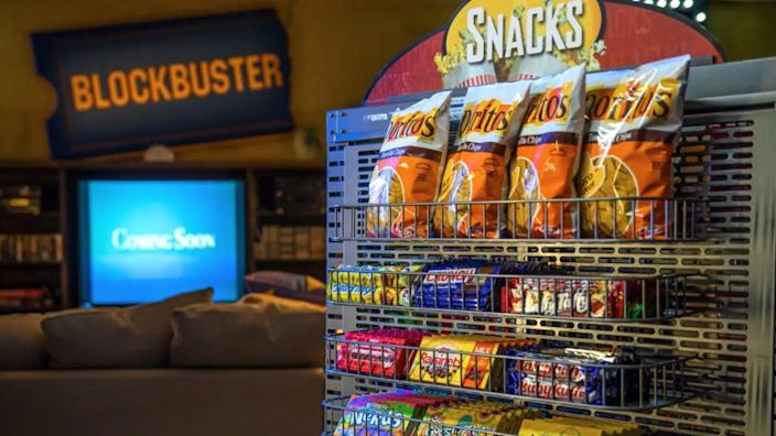 The retro interiors of Blockbuster Bend make the perfect space for a family to watch classic movies and scarf down some snacks.