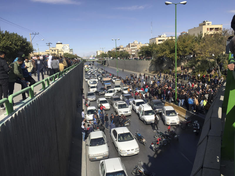 Cars block a street during a protest against a rise in gasoline prices, in the central city of Isfahan, Iran, Saturday, Nov. 16, 2019. Demonstrators angered by a 50% increase in government-set gasoline prices blocked traffic in major cities and occasionally clashed with police Saturday after a night of demonstrations punctuated by gunfire. (AP Photo)