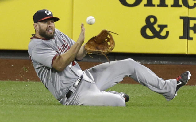 Washington Nationals left fielder Kevin Frandsen catches a ball hit by New York Mets' David Wright for an out to end the sixth inning of a baseball game Wednesday, Aug. 13, 2014, in New York. (AP Photo/Frank Franklin II)
