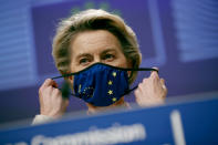 European Commission President Ursula von der Leyen puts on her protective face mask after addressing a media conference on Brexit negotiations at EU headquarters in Brussels, Thursday, Dec. 24, 2020. (AP Photo/Francisco Seco, Pool)