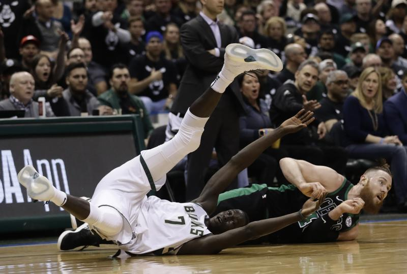 Milwaukee Bucks' Thon Maker gets tangles with Boston Celtics' Aron Baynes during the first half of Game 4 of an NBA basketball first-round playoff series Sunday, April 22, 2018, in Milwaukee. (AP Photo/Morry Gash)