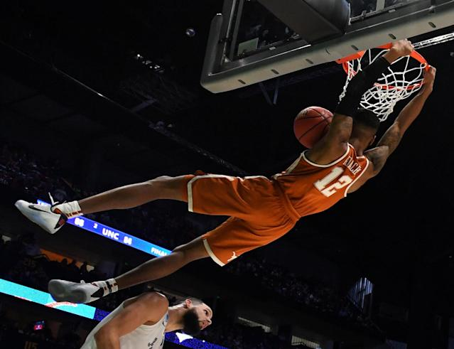 Mar 16, 2018; Nashville, TN, USA; Texas Longhorns guard Kerwin Roach II (12) dunks against Nevada Wolf Pack forward Caleb Martin (10) during the second half in the first round of the 2018 NCAA Tournament at Bridgestone Arena. Mandatory Credit: Christopher Hanewinckel-USA TODAY Sports TPX IMAGES OF THE DAY