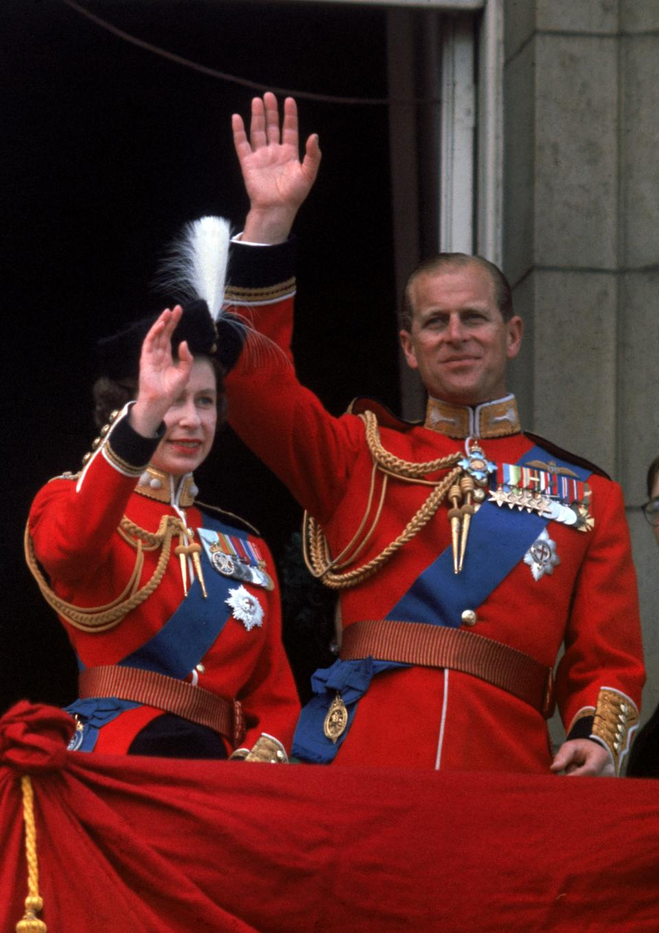 Waving from the balcony of Buckingham Palace during Trooping the Colour. [Photo: Getty]