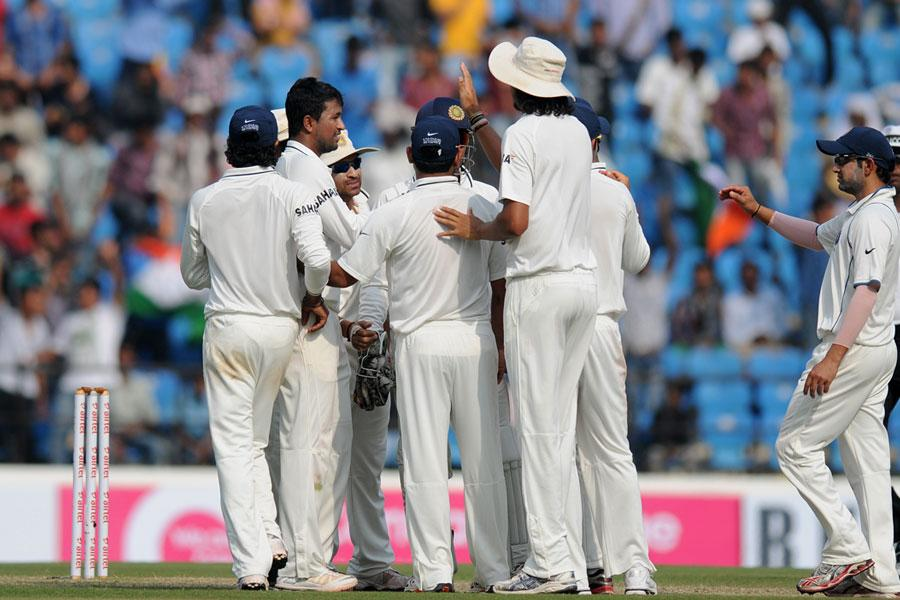 Pragyan Ojha celebrates after taking a wicket on Day 4 of the fourth cricket Test between India and England at the Jamtha Stadium in Nagpur,   Sunday, December 16, 2012. (c) BCCI