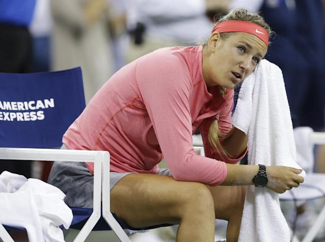 Victoria Azarenka, of Belarus, looks on from the bench after losing to Serena Williams during the women's singles final of the 2013 U.S. Open tennis tournament, Sunday, Sept. 8, 2013, in New York. (AP Photo/Darron Cummings)