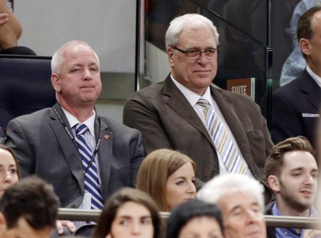 New York Knicks president Phil Jackson, right, watches during the first half of an NBA basketball game against the Toronto Raptors Wednesday, April 16, 2014, in New York. (AP Photo/Frank Franklin II)