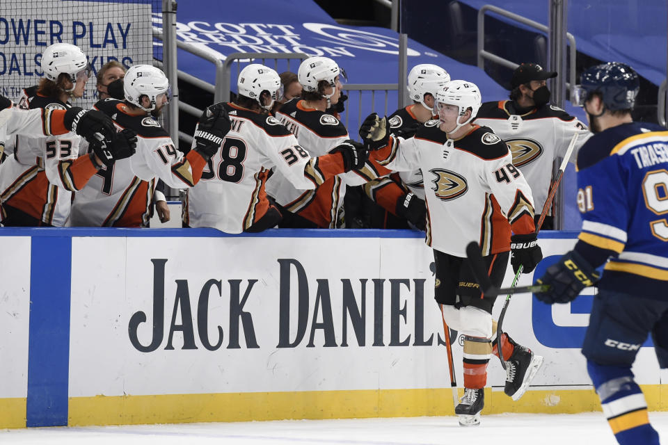Anaheim Ducks' Max Jones (49) is congratulated by teammates after scoring a goal against the St. Louis Blues during the second period of an NHL hockey game Friday, March 26, 2021, in St. Louis. (AP Photo/Joe Puetz)