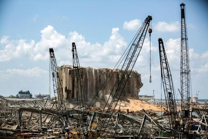 Cranes at the port of Lebanon's capital Beirut stand before the grain silos destroyed in the colossal explosion