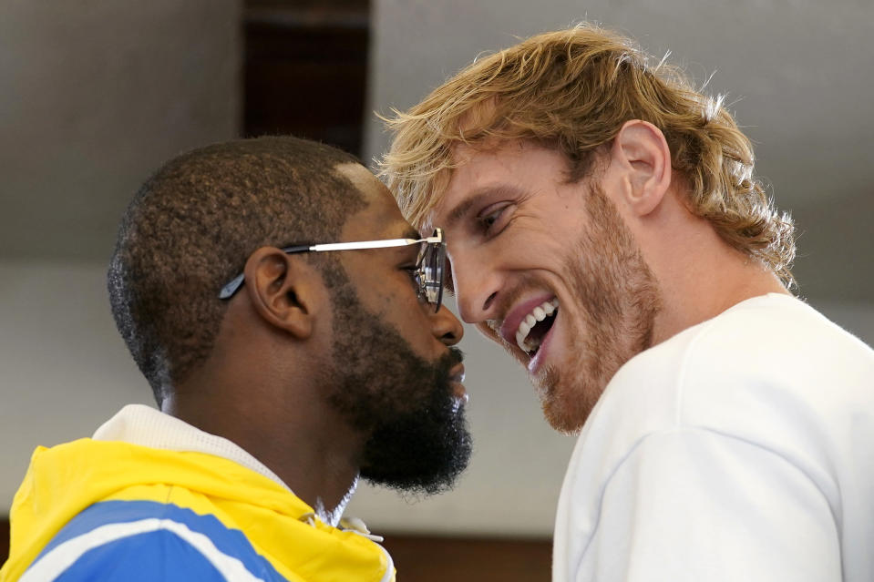 Floyd Mayweather, left, and Logan Paul, right, face off during a press event, Thursday, June 3, 2021, in Miami Beach, Fla. Mayweather will fight Paul in an exhibition boxing match at the Hard Rock Stadium in Miami Gardens, Fla. Sunday. (AP Photo/Lynne Sladky)