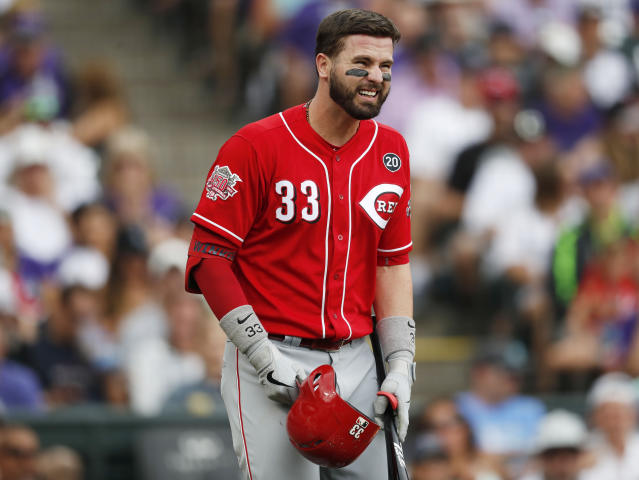 Cincinnati Reds' Jesse Winker reacts after hurting himself while swinging at a pitch from Colorado Rockies relief pitcher Jesus Tinoco in the sixth inning of a baseball game Sunday, July 14, 2019, in Denver. Winkler was forced to leave the game. (AP Photo/David Zalubowski)