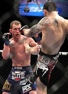 Gray Maynard parries a Frankie Edgar kick during their UFC lightweight title bout Saturday night