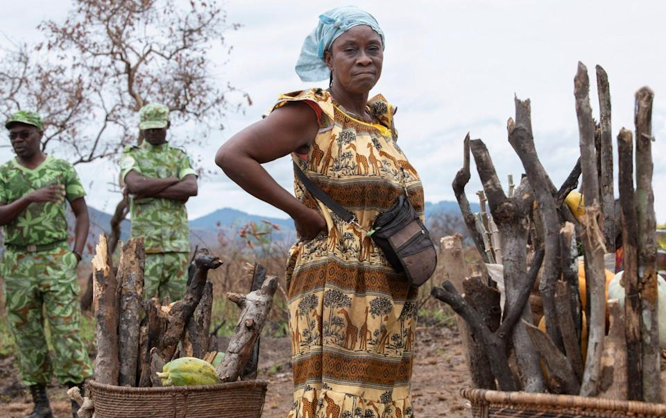 Mamma Georgette, 55, with firewood and her daily harvest in Gabon - David Rose